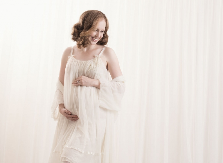 photo of pregnant woman in vintage maternity dress
