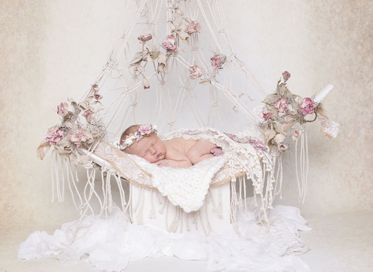 girly newborn photos in vintage props