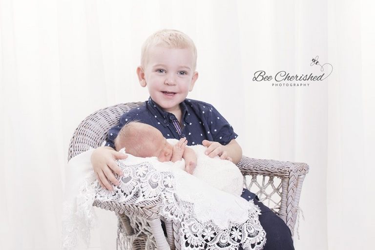 cutest newborn and big brother photo