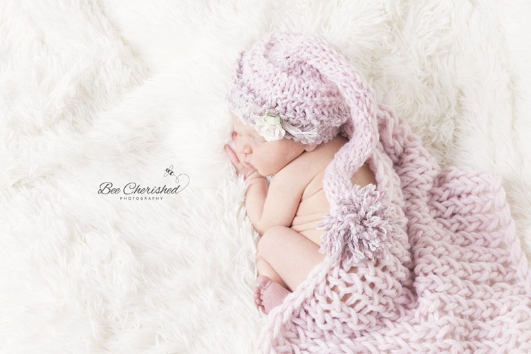 cutest newborn baby girl so tiny with a cute knitted hat
