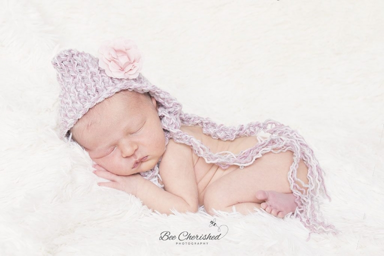 tiny newborn baby girl with cute little hat