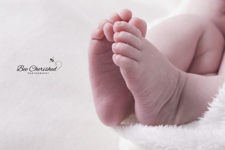 newborn feet close up photo