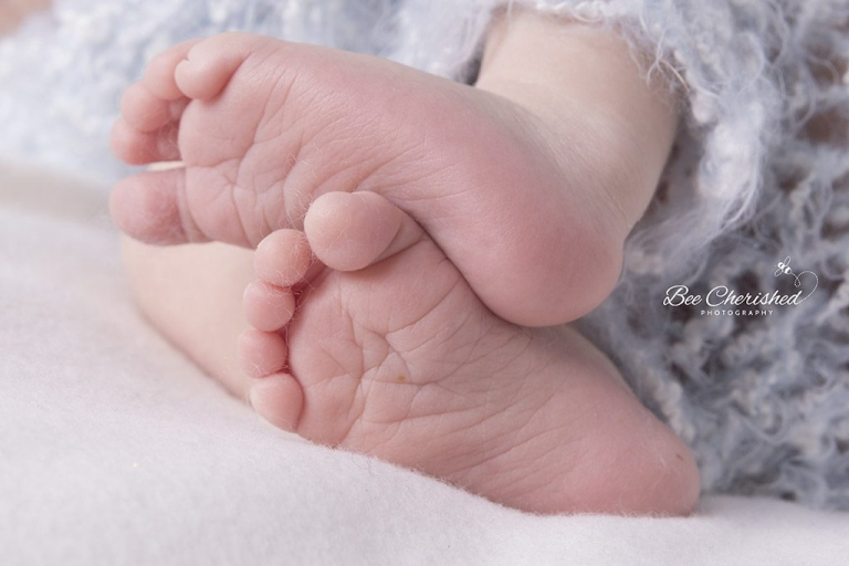 Adorable baby feet close up photo