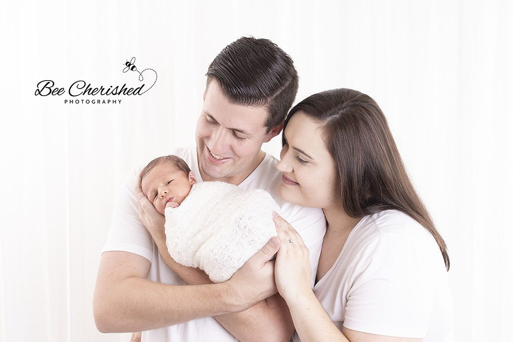 family newborn photos with Dad holding baby